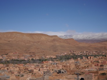 Snow-capped Atlas Mountains in the distance